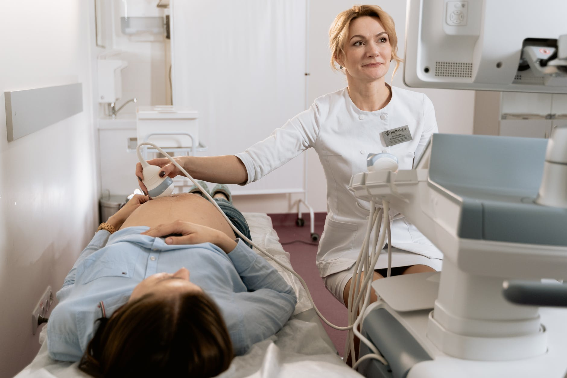 photo of gynecologist doing an ultrasound on a pregnant woman